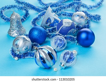 Many Christmas decorations toys on light blue background
