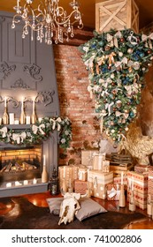 many Christmas gifts. Winter home decor. Christmas in loft interior against brick wall.