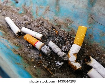 Many cigarette stub in ashtray, Old cigarettes filter in ashtray