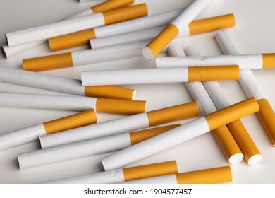 Many cigarettes stacked together. Drugs are harmful to the respiratory system.