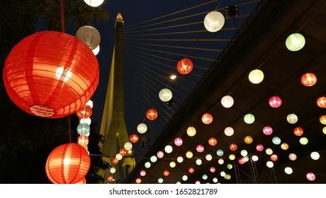 Many circular lamps at night