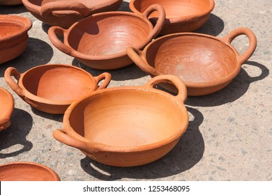 Many clay bowl, of baked clay kept in the sun to dry. Traditional handmade bowl, on the island of Sri Lanka.