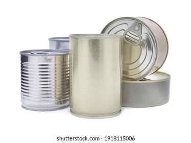 Many closed tin cans on white background