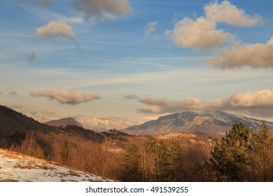 many clouds over the mountains of Italy in a winter day