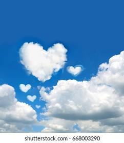many clouds shaped heart on blue sky/ Love background