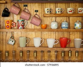 many coffee cup on wood shelf background