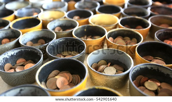 Many coins for make merit