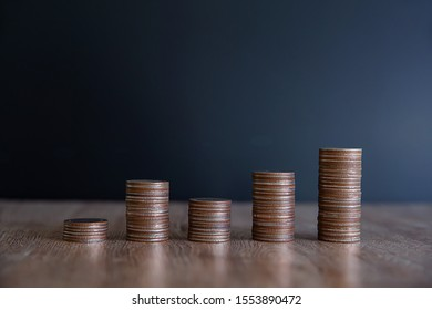 Many coins are stacked in a graph shape for financial planning concepts.