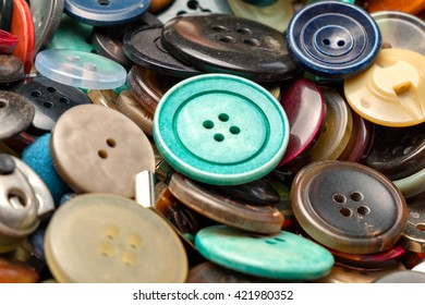 many collected colorful buttons in a box