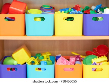 Many colored boxes with toys