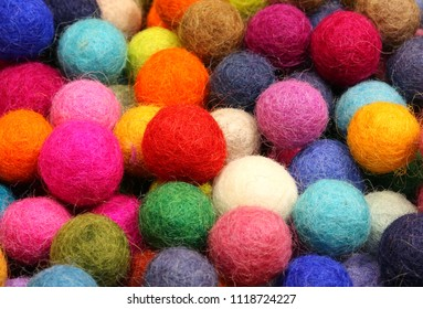Many colored felt balls forming a background