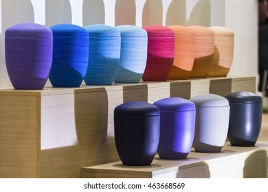 Many colored funerary urns.