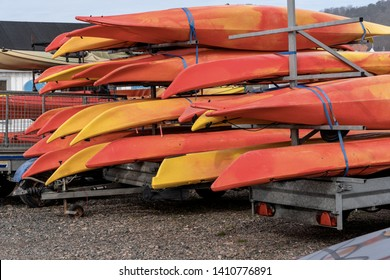 Many colored kayaks canoes are on an car trailer in rental center. Active lifestyle sport concept.