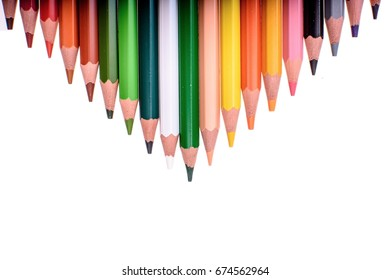 Many colored pencils isolated on white background, place for text.