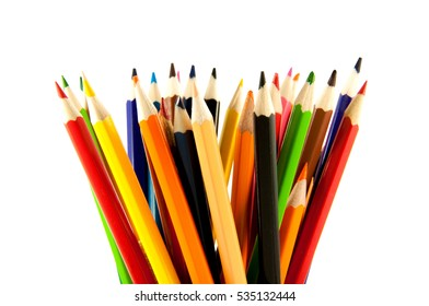 many colored pencils in a vertical position on a white background