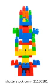 Many colored pieces forming one tower isolated on white