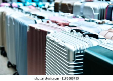 Many colored suitcases in shop.