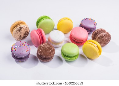 Many colored sweet macaroons cookie isolated on a white background
