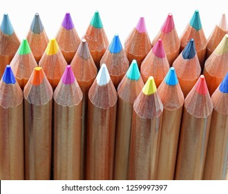 many colored wooden pencils on white background