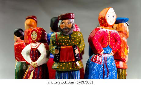 Many colored wooden people peasants handmade made of wood.