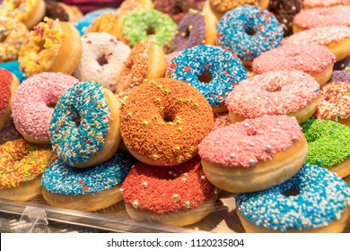 Many colorful assorted donuts