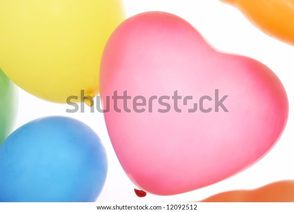 many colorful balloons on a white background