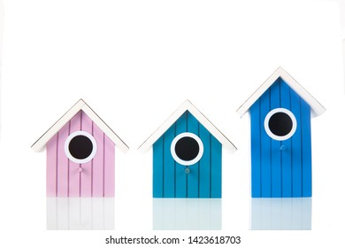 Many colorful bird boxes isolated over white background