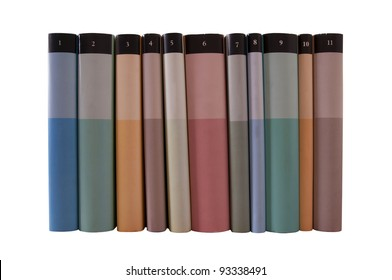 Many colorful books in a row isolated on white background