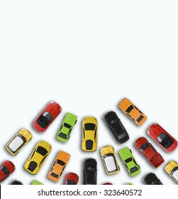 Many colorful car toys isolated on white background