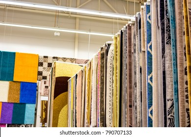 Many colorful carpets in the store