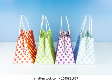 many colorful dotted shopping bags