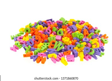many colorful foam letters isolated over white background