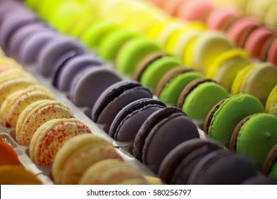 Many colorful macarones (macaroones), french sweet cookies closeup