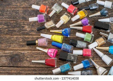 Many colorful nail polishes on the table