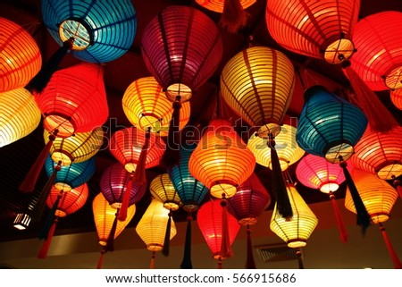 many colorful paper lanterns on ceiling stock photo edit now