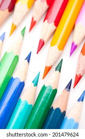 Many colorful pencils with tips against each other