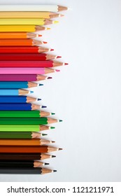 many colorful pens in  several arrangements