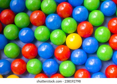 Many colorful plastic balls on children's playground