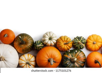 Many colorful pumpkins frame isolated on white background, autumn harvest , Halloween or Thanksgiving concept