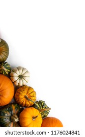 Many colorful pumpkins frame isolated on white background, autumn harvest, Halloween or Thanksgiving concept