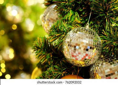 Many colorful shiny mirror balls on an artificial tree in a department store in a happiness festival such as Christmas and New Year festival, beautiful decoration for promoting to lovers and family