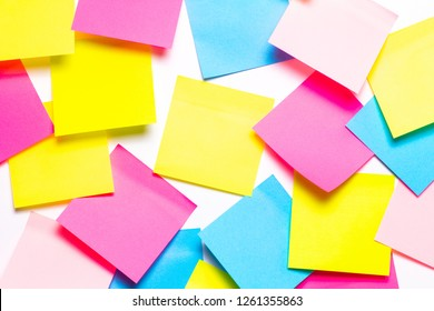 Many colorful sticky notes on white background