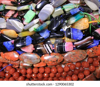 Many colorful stone necklaces as a natural background