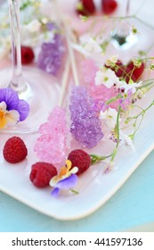 Many colorful sugar crystal candy on wooden stick