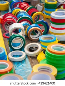 Many colorful tape rolls at a market. Office supply in abundance.