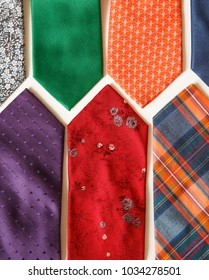 many colorful ties