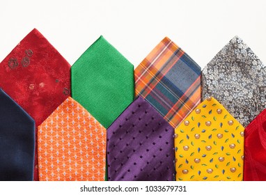 many colorful ties isolated over whit