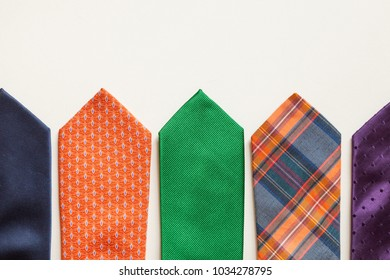 many colorful ties isolated over white