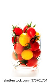 Many colorful tomato in the glass