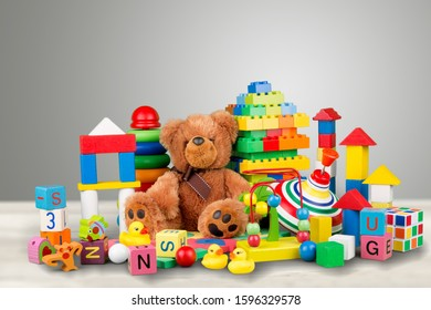 Many colorful toys collection on pastel background